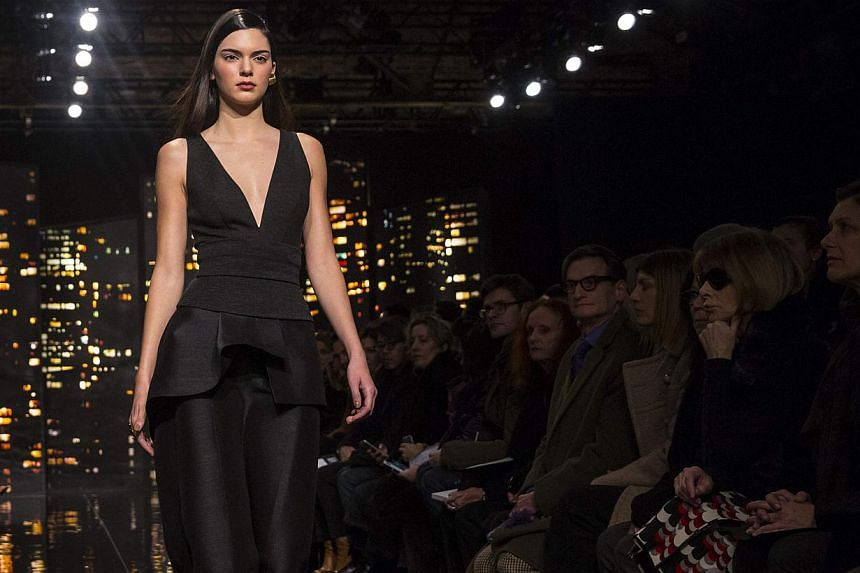 Model Kendall Jenner presents a creation from the Donna Karan New York Fall/Winter 2015 collection at the New York Fashion Week on Feb 16, 2015. -- PHOTO: REUTERS