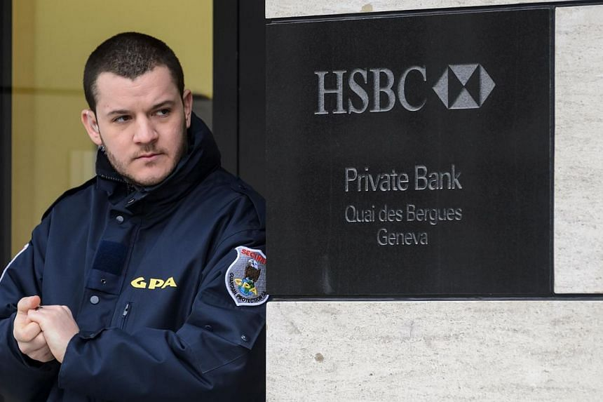 A private security guard secures the entrance of the HSBC Private Bank branch in Geneva on Feb 18, 2015. Ten days after a massive tax fraud scandal erupted surrounding British banking giant HSBC's Swiss branch, Swiss prosecutors announced a money lau