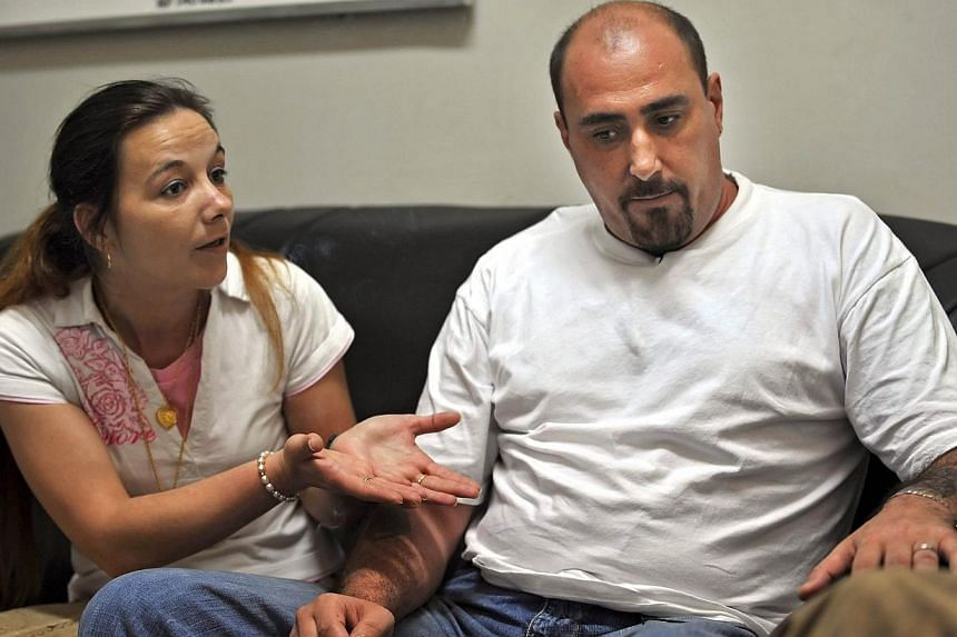 Serge Atlaoui (right) and his wife Sabine (left) tell their story during an interview on March 25, 2008, in this file photo. -- PHOTO: AFP