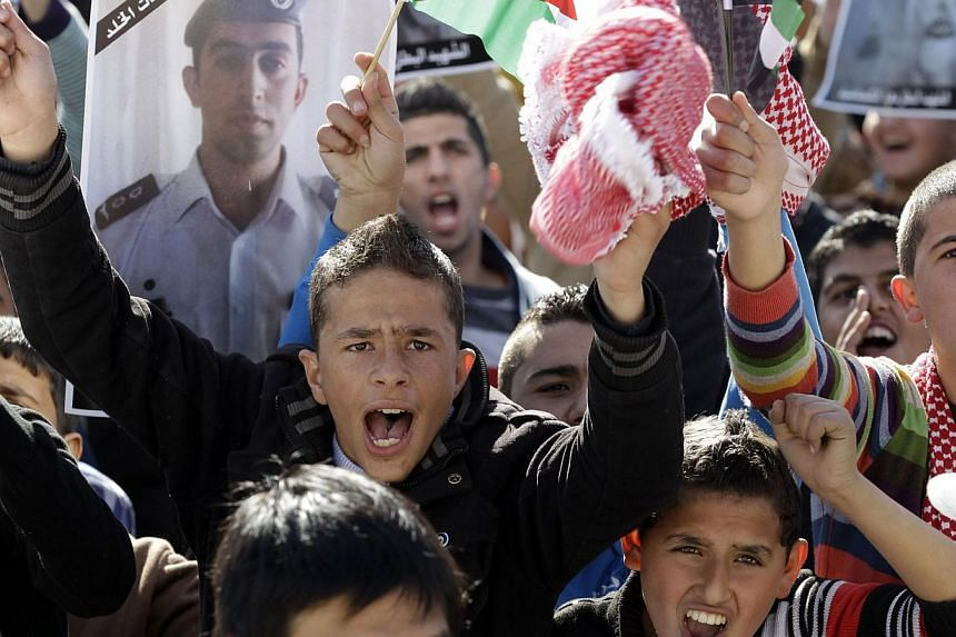 Young Jordanians shouting slogans on Feb 5, 2015 in Amman during a rally against the Islamic state group and in reaction to the burning of Jordanian pilot Maaz al-Kassasbeh by the group's militants. -- PHOTO: AFP