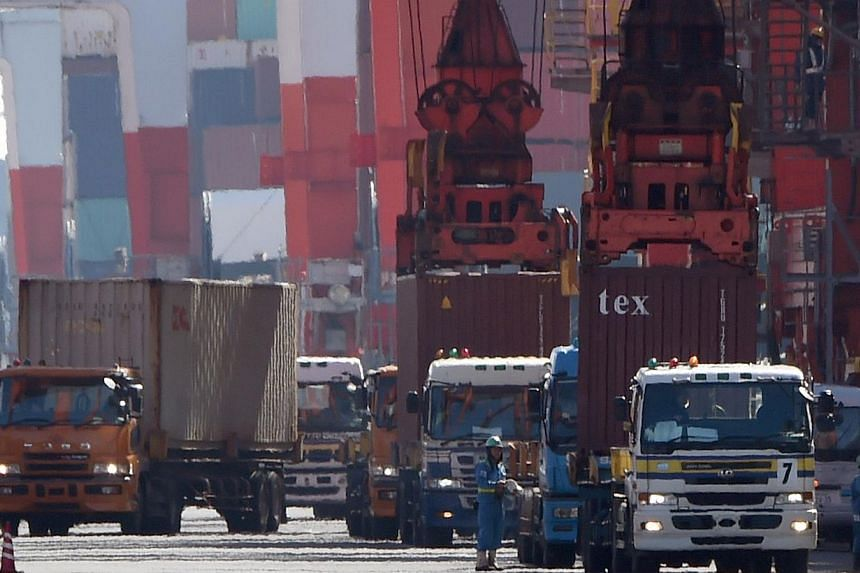 Containers at a pier in Tokyo on Feb 19, 2015. Japanese manufacturing activity expanded at the slowest pace in seven months in February as domestic order growth slowed, but orders from overseas picked up in an encouraging sign that economic growth wi