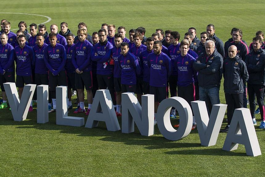FC Barcelona's players and members pose for a family photo during a renaming ceremony at the sports complex of Sant Joan Despi in Barcelona, north-eastern Spain on Feb 20, 2015. -- PHOTO: EPA