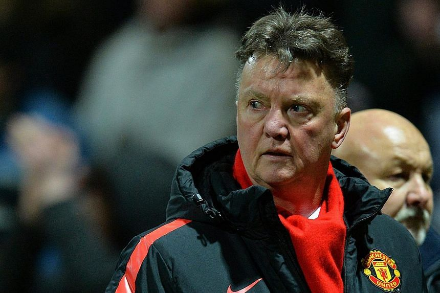 Manchester United's Dutch manager Louis van Gaal reacts during the English FA Cup fifth round soccer match between Preston North End and Manchester United at the Deepdale in Preston, Britain, on Feb 16, 2015. -- PHOTO: EPA