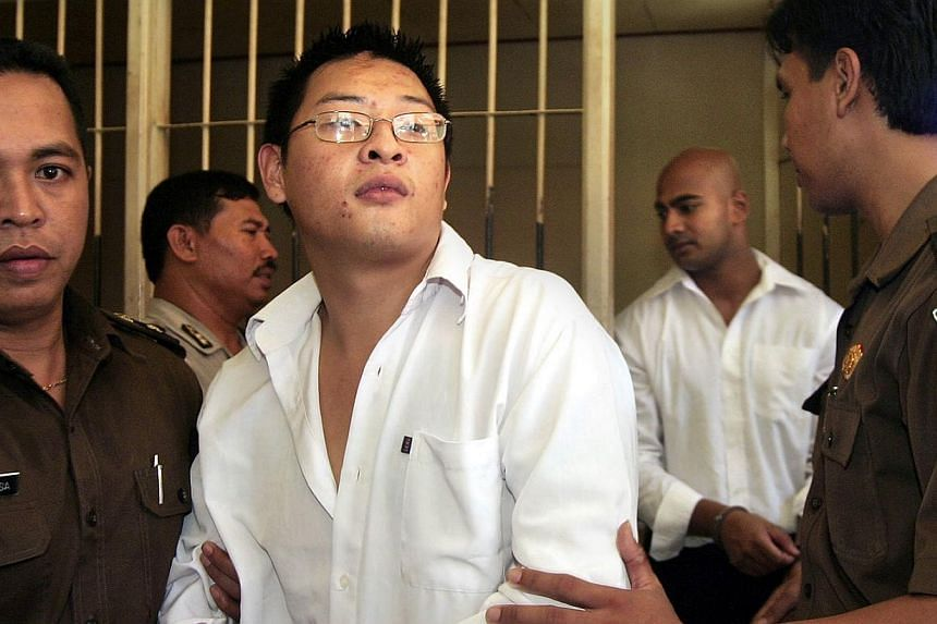 In this file photograph taken on Feb 14, 2006, Australian drug smugglers Andrew Chan (centre) followed by Myuran Sukumaran (right in white shirt), are escorted by prison guards following a court hearing in Denpasar, on Bali island. The execution of t