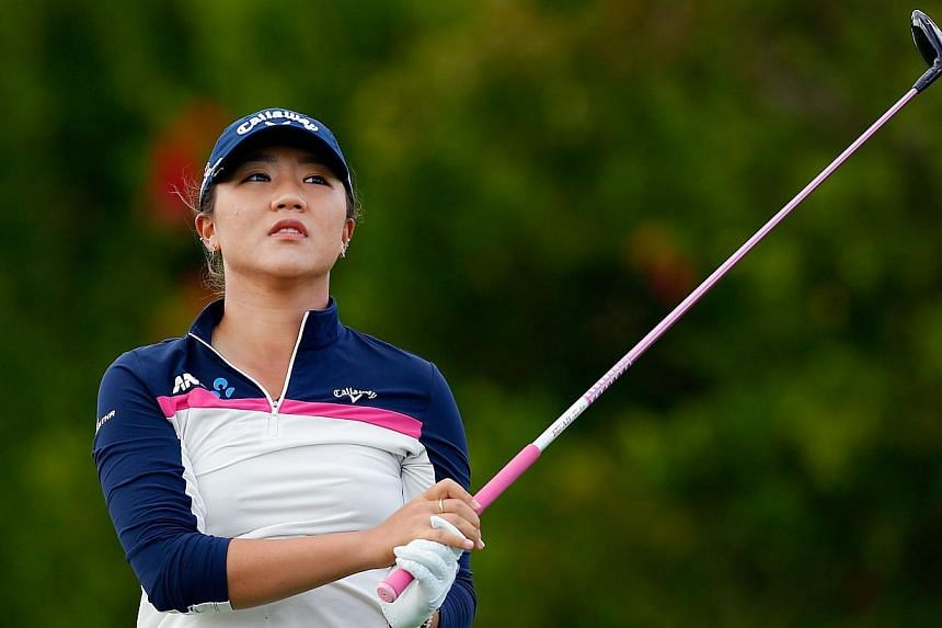 Lydia Ko of New Zealand hits a tee shot on the eighth hole during round two of the Pure Silk Bahamas LPGA Classic at the Ocean Club course on Feb 6, 2015, in Paradise Island, Bahamas. Ko shot a second straight three-under par 70 on Friday to grab a s