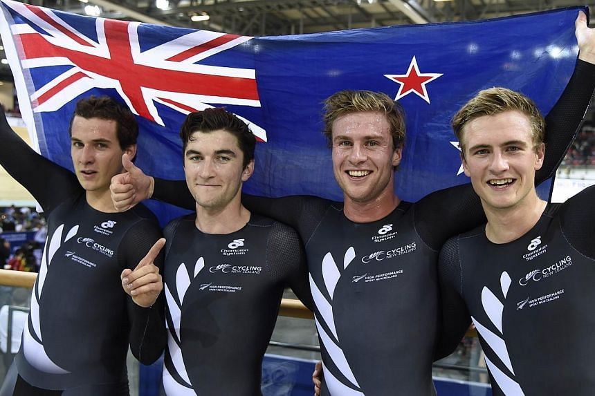 Members of the New Zealand team (from left) Marc Ryan, Dylan Kennett, Pieter Bulling, and Alex Frame pose after winning the Men's Team Pursuit Final at the UCI Track Cycling World Championships on Feb 19, 2015. -- PHOTO: AFP