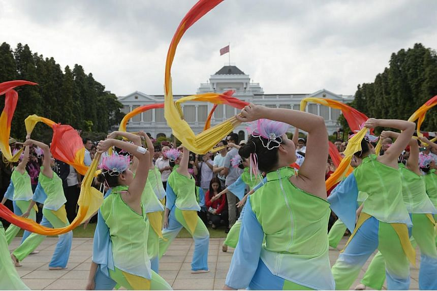 Dancers from the SOKA Sunflower Dance Ensemble peform at the Istana Lawn during the Chinese New Year open house at the Istana on Feb 20, 2015. -- PHOTO: MARK CHEONG