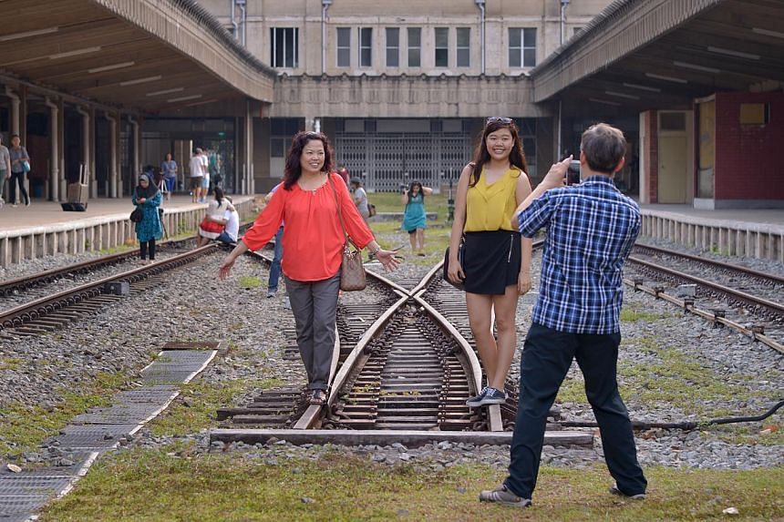 Visitors taking pictures on what is left of the railway track at Tanjong Pagar Railway Station on Feb 20, 2015, the second day of Chinese New Year. -- ST PHOTO:LIM SIN THAI