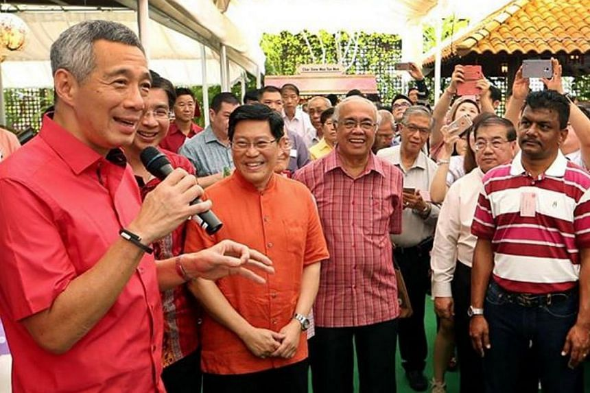 There was also plenty of festive cheer as Prime Minister Lee Hsien Loong (left) and his wife hosted a Chinese New Year open house at their home, just days after he underwent surgery to remove his prostate gland.-- PHOTO: FACEBOOK/ LEE HSIEN LOO