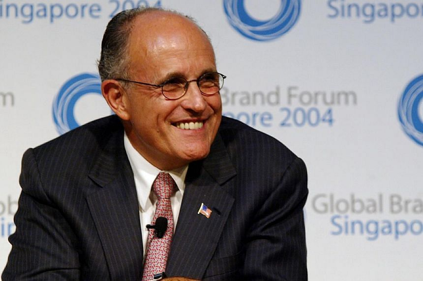 """Former New York mayor Rudy Giuliani - above, in a 2004 file photo, during a trip to Singapore - has triggered a firestorm with an unflinching verbal assault on Barack Obama, saying the US President does not """"love"""" America. -- ST FILE PHOTO"""