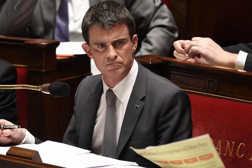 French Prime Minister Manuel Valls is pictured during the debate held prior to a parliamentary vote of no-confidence over the government's economic reforms, on Feb 19, 2015 at the French national Assembly in Paris. -- PHOTO: AFP
