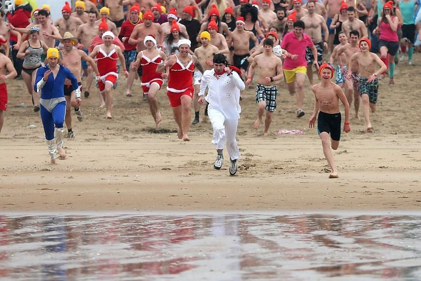 Participants run towards the waters of the North Sea during the annual New Year swim in Ostend, Belgium on Jan 3, 2015. The month of January was the second warmest on record, according to an analysis of global averages for temperature over land and s