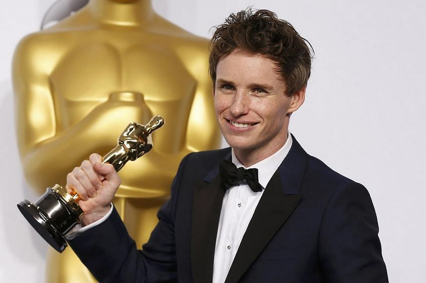 Eddie Redmayne poses with his Oscar for best actor nominee for his role in The Theory Of Everything at the 87th Academy Awards in Hollywood, California on Feb 22, 2015. -- PHOTO: REUTERS