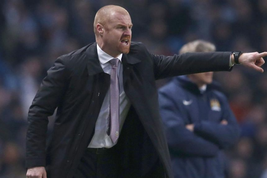 Burnley manager Sean Dyche reacts during their English Premier League soccer match against Manchester City at the Etihad Stadium in Manchester, northern England on Dec 28, 2014. -- PHOTO: REUTERS