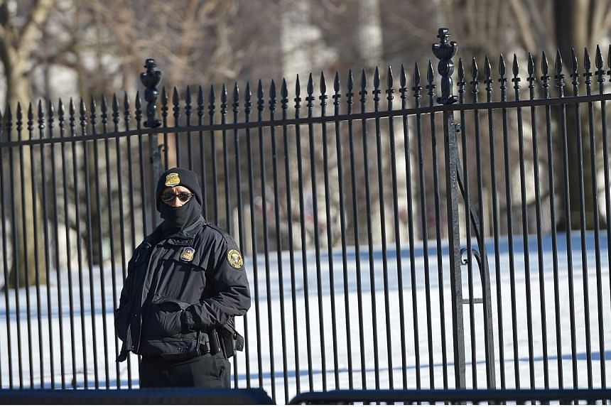 A member of the Secret Service standing outside the White House on Feb 23, 2015, in Washington, DC. A Department of Homeland Security shutdown grows increasingly likely with lawmakers fighting over funding for the US agency amid a standoff about Pres