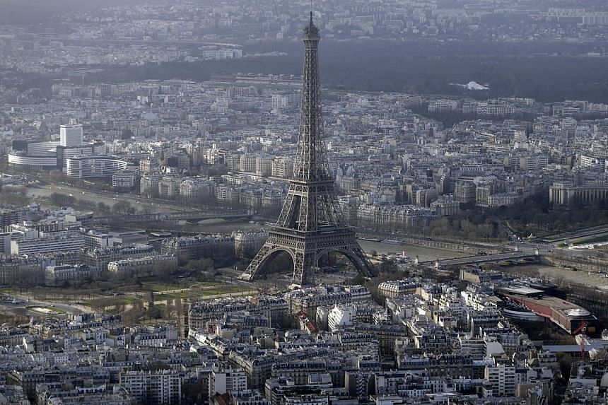 Drones have been spotted flying over central Paris landmarks, including the Eiffel Tower, at night. -- PHOTO: AFP