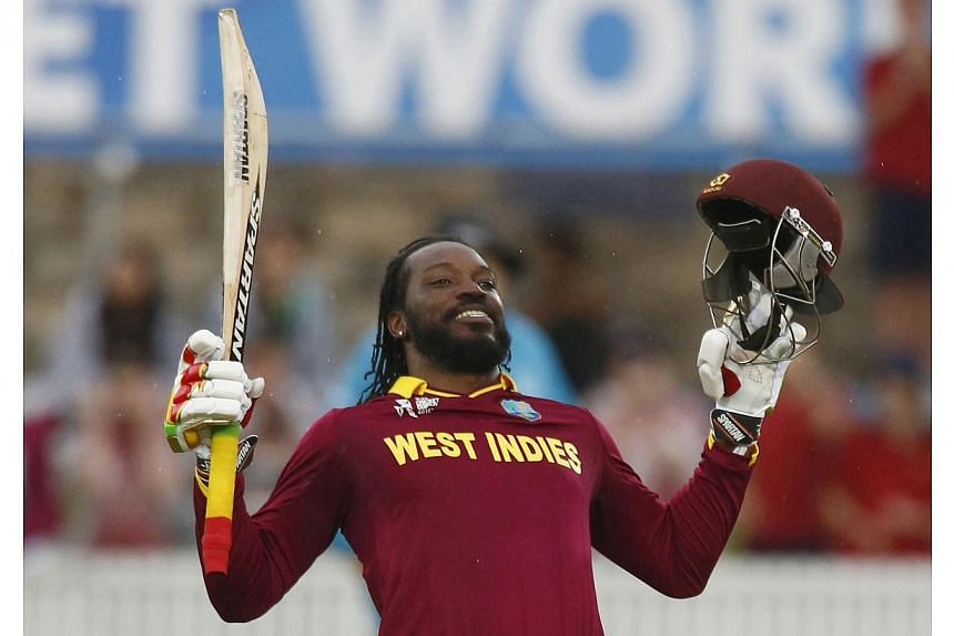 West Indies batsman Chris Gayle celebrates scoring 200 runs, a double century, during their World Cup Cricket match against Zimbabwe in Canberra on Feb 24, 2015. Gayle smashed the highest-ever individual World Cup score with his 215 to power the