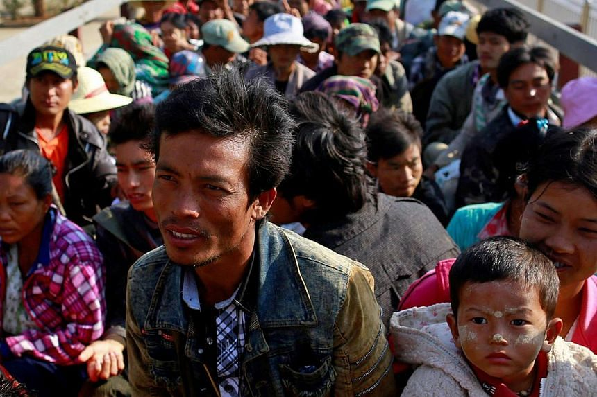 Migrant workers who fled from Karmine ride a vehicle to return home, after staying at a temporary refugee camp in Lashio Feb 21, 2015. Fighting broke out on Feb 9 between the army and a rebel force in the Kokang region of northeast Myanmar, on the bo
