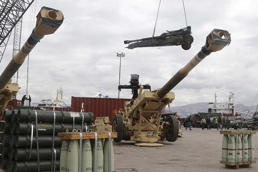 Workers unload artillery pieces donated from the US government to the Lebanese army, during a ceremony at Beirut's port on Feb 8, 2015. Fellow Middle Eastern nation Jordan has also delivered heavy military equipment to Lebanon to bolster their fight