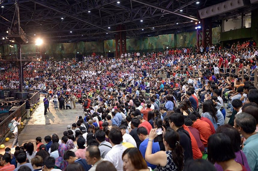 Minister for Community, Culture and Youth Lawrence Wong speaking to the 4000-odd volunteers for the 28th SEA Games at Universal Studios on Feb 24, 2015. He hosted an appreciation night for the volunteers of the Singapore SEA Games at Universal Studio