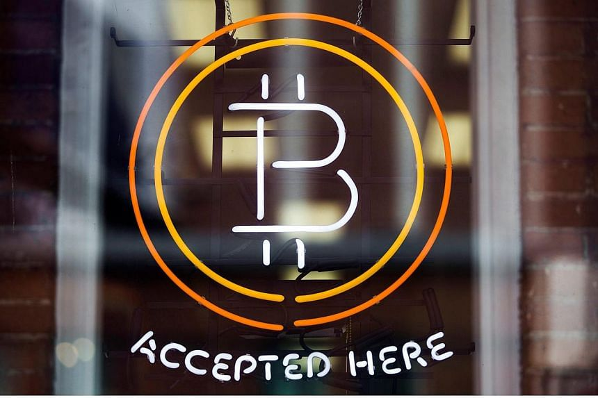 A Bitcoin sign is seen in a window in Toronto, in this file photo on May 8, 2014.Hi-tech criminals are increasingly selling live streams of child sex over legitimate chat sites and apps such as Skype for hard-to-trace virtual currencies like Bi