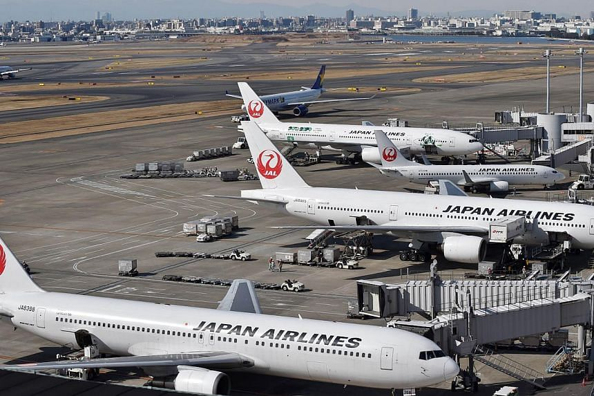 Japan appears set to relax rules to let pilots fly until they are 67 as it tries to ease a shortage created by the growing popularity of air travel, an official said Tuesday. -- PHOTO: AFP