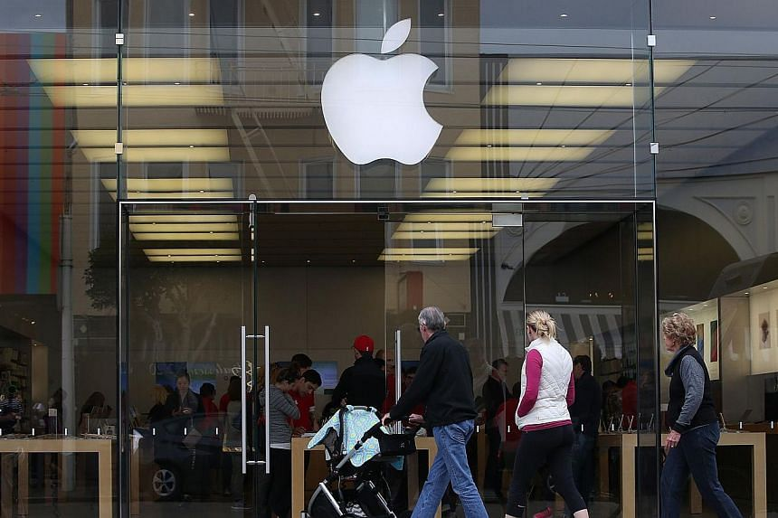 Apple Pay is available in the recently updated iPhone 6 software and accepted in 220,000 stores. It allows iPhone users to pay for purchases using their iPhone's NFC capabilities instead of using their credit card. -- PHOTO: AFP