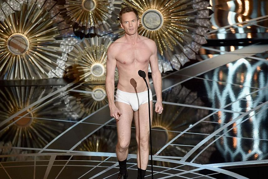 Host Neil Patrick Harris stands in his underwear onstage during the 87th Annual Academy Awards at Dolby Theatre on Feb 22, 2015 in Hollywood, California. -- PHOTO: AFP