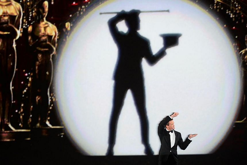 Host Neil Patrick Harris performs onstage during the 87th Annual Academy Awards at Dolby Theatre on Feb 22, 2015 in Hollywood, California. -- PHOTO: AFP
