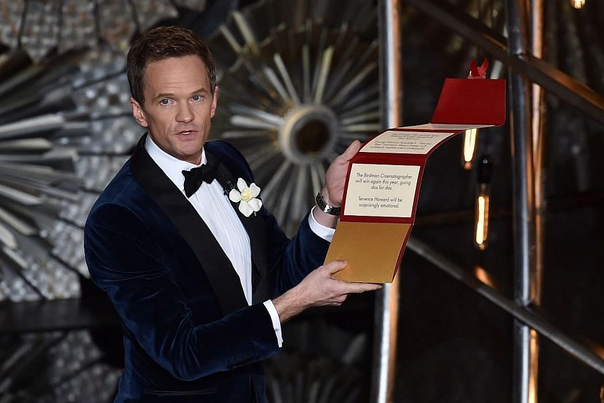 Host Neil Patrick Harrisopens his locked envelope onstageduring the 87th Annual Academy Awards at Dolby Theatre on Feb 22, 2015 in Hollywood, California. -- PHOTO: AFP