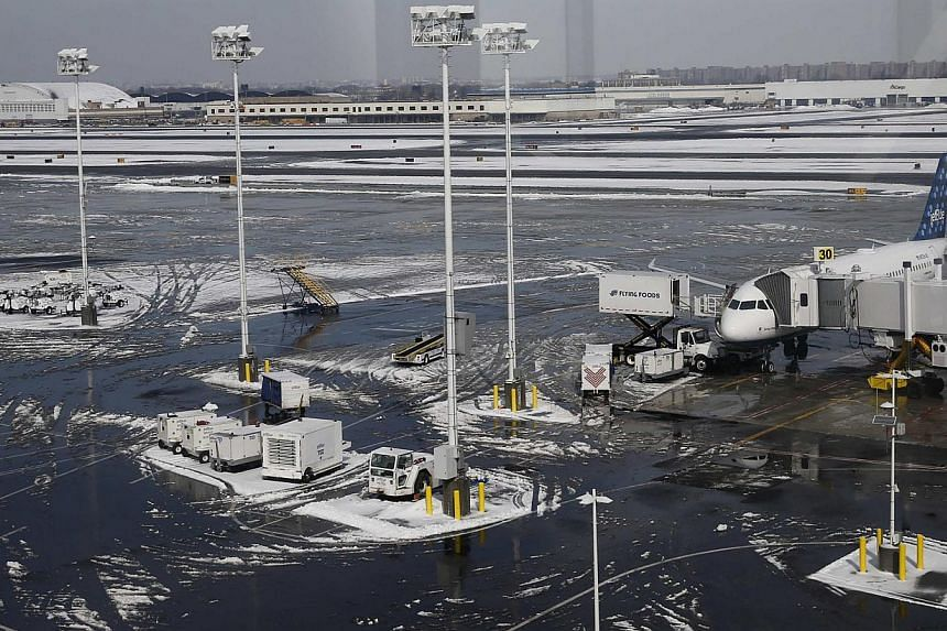 A JetBlue aircraft is seen parked at JFK International Airport in New York on Feb 22, 2015. -- PHOTO: REUTERS