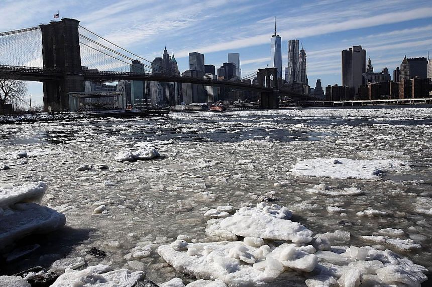 A build-up of ice in the East River near the Brooklyn Bridge on Feb 23, 2015, in New York City. -- PHOTO: AFP