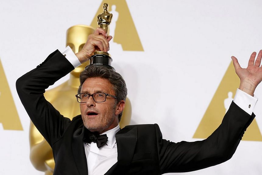 Filmmaker Pawel Pawlikowski, winner of the Best Foreign Language Film Award for Ida, poses in the press room during the 87th Annual Academy Awards at Loews Hollywood Hotel on Monday in California. -- PHOTO: AFP