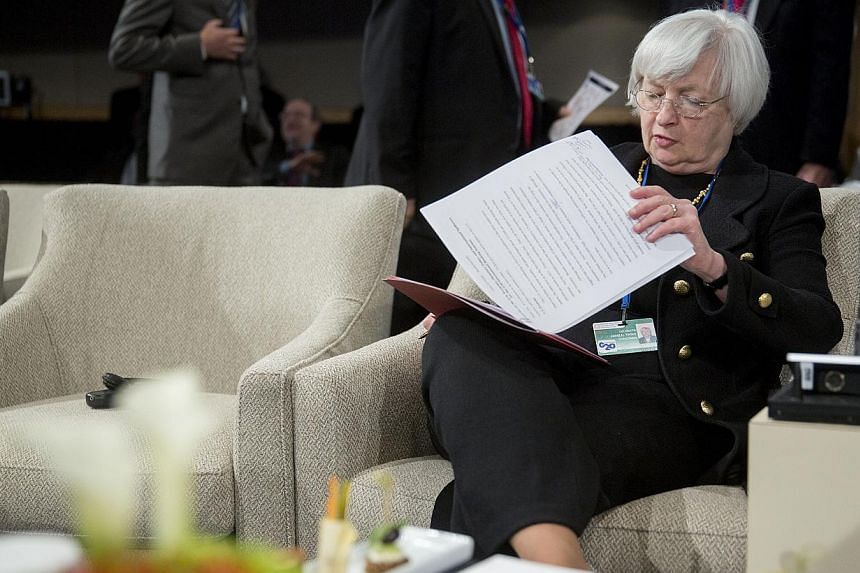Janet Yellen, chair of the US Federal Reserve, attends an International Monetary Fund Committee (IMFC) governors meeting at the International Monetary Committee (IMF) and World Bank Group Annual Meetings in Washington, D.C., U.S., on Oct. 11, 2014. -