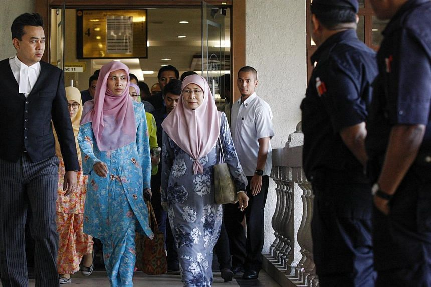 Madam Wan Azizah (centre), wife of Malaysian opposition leader Anwar Ibrahim, attending her husband's court case against Foreign Affairs Minister Anifah Aman in the Duta Court Complex at Kuala Lumpur, Malaysia on Feb 17, 2015. -- PHOTO: EPA