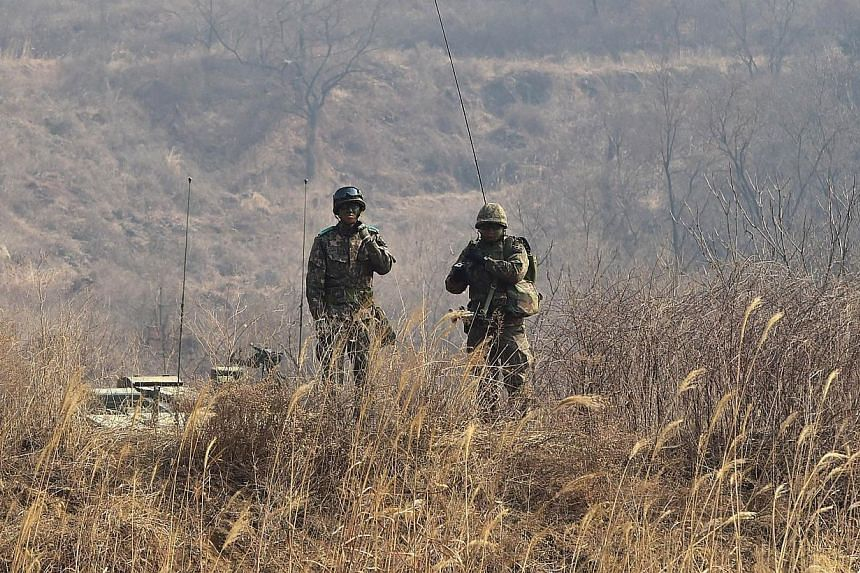 South Korean soldiers standing on the top of a hill during a live-fire drill in Yangpyeong, 60km east of Seoul, on Feb 11, 2015. -- PHOTO: AFP
