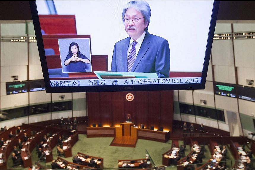 Hong Kong Financial Secretary John Tsang delivering the annual Hong Kong government Budget to the city's Legislative Council. -- PHOTO: EPA