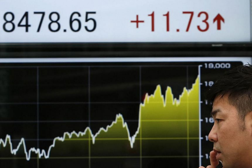 Asian stocks rose on Feb 25, 2015, thanks to gains on Wall Street after Federal Reserve Chair Janet Yellen suggested she would not rush into raising interest rates. -- PHOTO: REUTERS