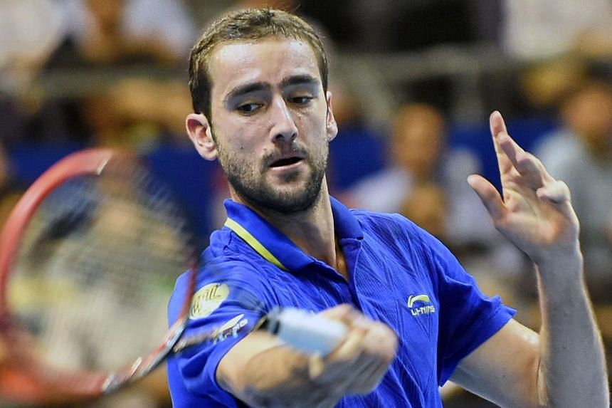Croatia's Marin Cilic of the United Arab Emirates Royals plays against France's Jo-Wilfreid Tsonga of the Manila Mavericks during their men's singles at the International Premier Tennis League (IPTL) competition in Singapore on Dec 3, 2014. -- PHOTO: