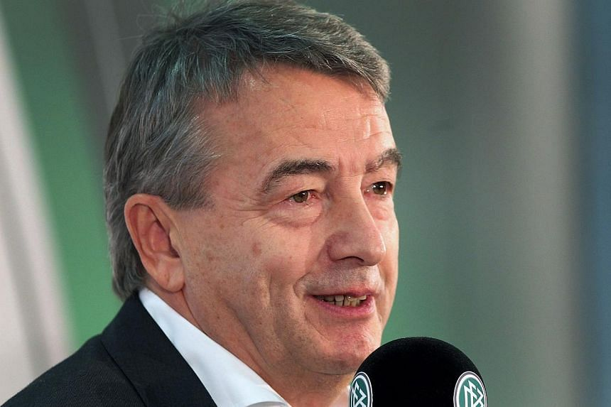 Mr Wolfgang Niersbach, President of the German Football Federation (DFB), addresses the media during a news conference in Frankfurt am Main, western Germany, on Dec 16, 2014. -- PHOTO: AFP