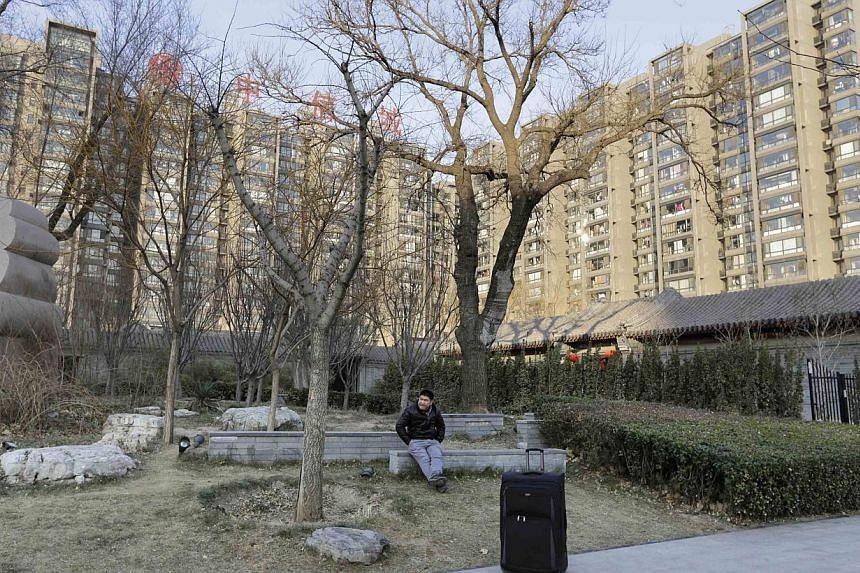 Apartment blocks in central Beijing on Dec 22, 2014. -- PHOTO: REUTERS