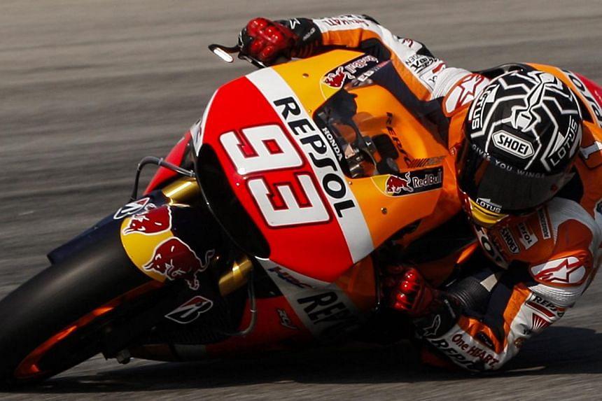 Spanish MotoGP rider Marc Marquez of Repsol Honda team in action at the Sepang International Circuit outside Kuala Lumpur, Malaysia on Feb 25, 2015.Marquez was the fastest rider for the second successive day at Malaysia's Sepang circuit on Wedn