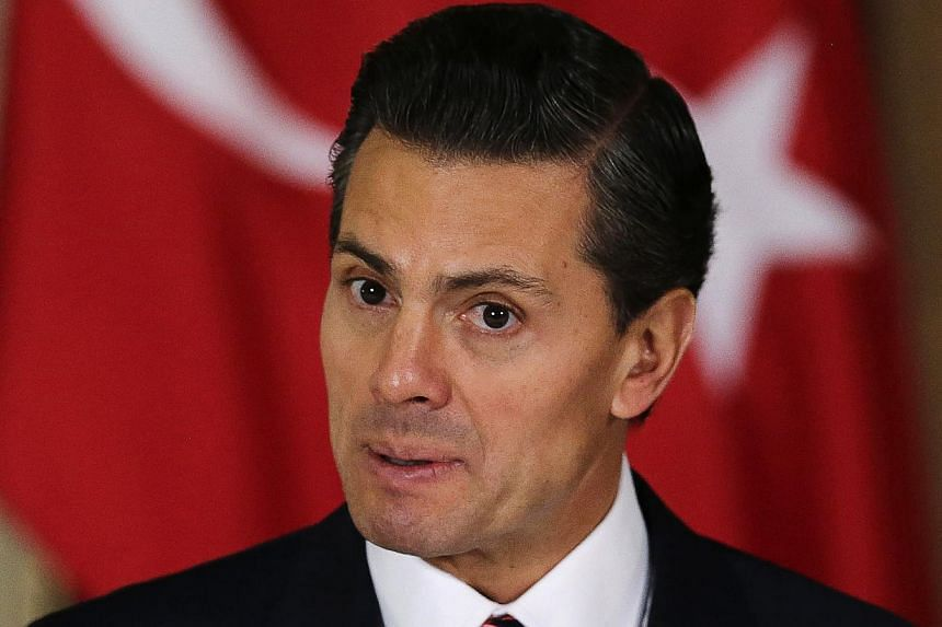 Leaders in Mexico's Lower House of Congress have reached an agreement on an anti-corruption Bill, delivering a boost to President Enrique Pena Nieto (above), who is trying to free himself from a damaging conflict of interest row. -- PHOTO: REUTERS