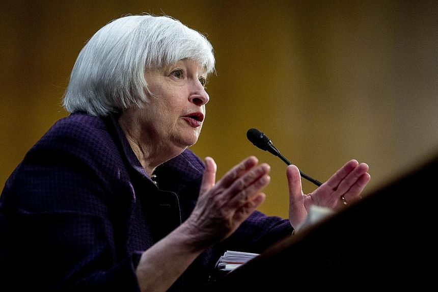 Fed chairman Janet Yellen told a US Senate panel that the central bank was deep in preparation for the move to raise interest rates, after keeping the rate at zero for more than six years. -- PHOTO: BLOOMBERG