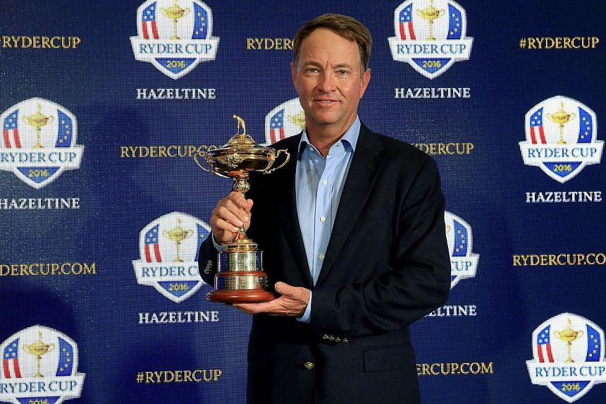 Davis Love III holds the Ryder Cup Trophy as he poses for the media during his announcement as the 2016 United States Ryder Cup Team Captain at the PGA headquarters on Feb 24, 2015 in Palm Beach Gardens, Florida. -- PHOTO: AFP