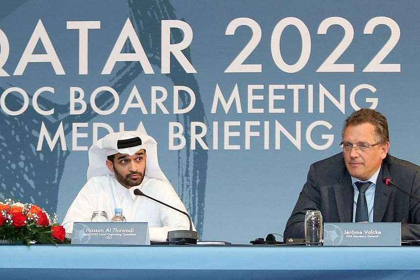 Fifa Secretary General Jerome Valcke (right) and head of the Qatar 2022 World Cup organising committee Hassan al-Thawadi give a press conference to defend the football's ruling body's controversial proposal to shift the 2022 World Cup from the normal