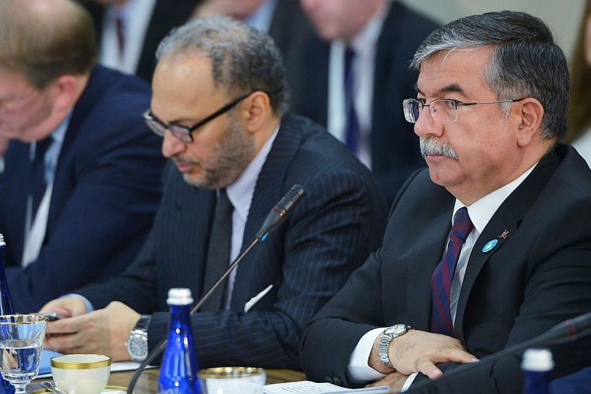 Turkey's Minister of National Defense Ismet Yilmaz (extreme right) take part in the White House Summit on Countering Violent Extremism Foreign Fighter Ministerial on February 18, 2015 at the State Department in Washington, DC.Turkeyhas al