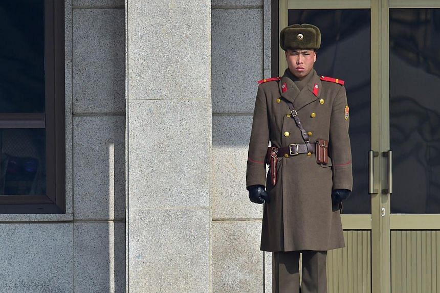 """A North Korean soldier stands guard at the North side of the truce village of Panmunjom in the Demilitarized Zone dividing the two Koreas on February 4, 2015.The United States is """"deeply concerned"""" about North Korea's nuclear advances, a senior"""