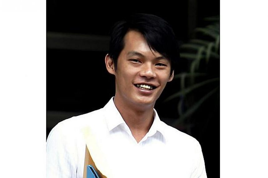 Ng Shi Qiang, 31, was jailed for five years and nine months and ordered to be given six strokes of the cane, after pleading guilty to having unlawful possession of a Beretta pistol. -- ST PHOTO: WONG KWAI CHOW