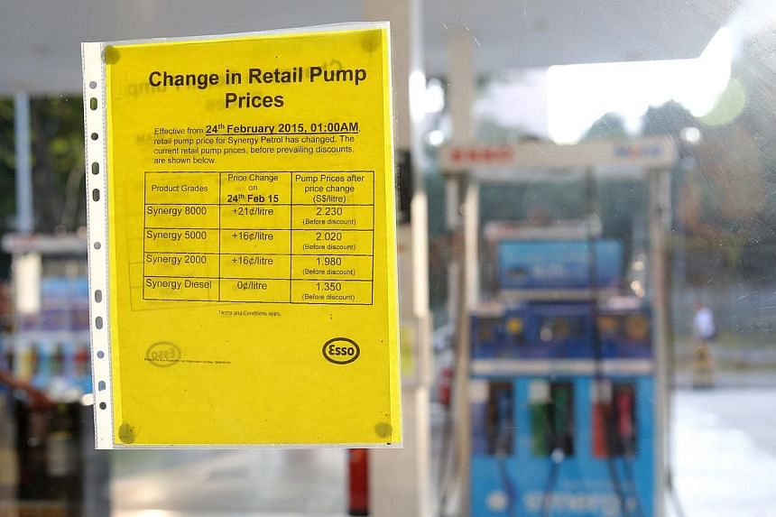 A sign showing price changes at an Esso station on Feb 25, 2015. -- ST PHOTO: ONG WEE JIN